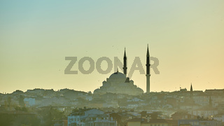 Silhouette of a Mosque Fatih in a fog and sunlight reflections. Vintage style.
