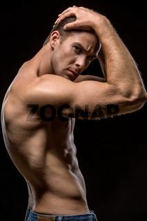 Guy with naked torso in studio