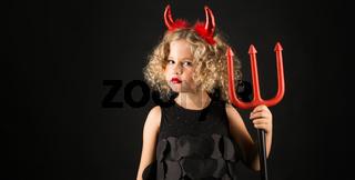 Cute girl in devil costume