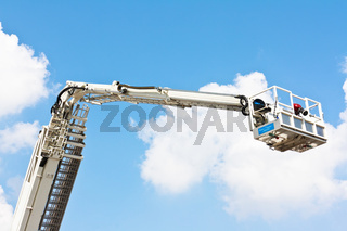 Articulated aerial hydraulic platform against a blue sky