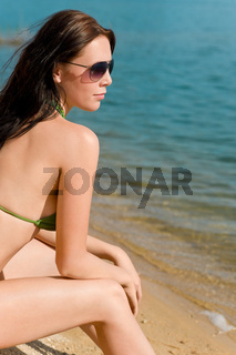 Summer woman in bikini alone on beach