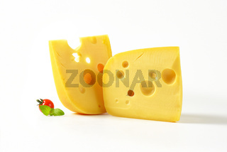 wedges of yellow cheese with eyes