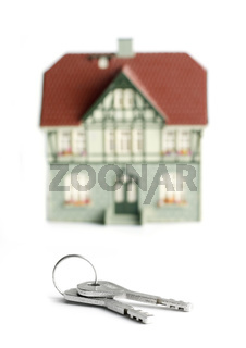 House and keys over white
