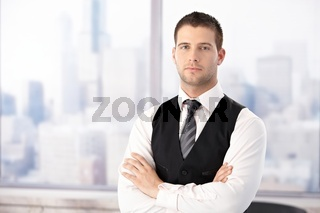 Portrait of handsome businessman in office