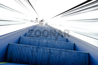 Going up on blue moving escalator to white light