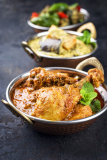 Traditional Indian Curries with Chicken and Vegetable as close-up Korai