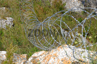 Modern barbed wire fence around a property