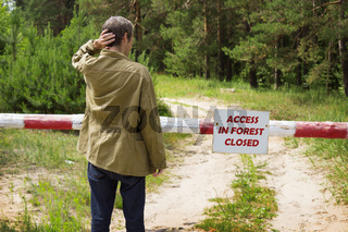 Man reading banning attend forest