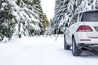 Car in snow-covered winter scenery
