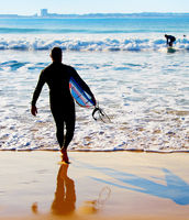 Surfer going to the ocean