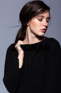 Portrait of beauty young brunette woman portrait in black fashion female pullover