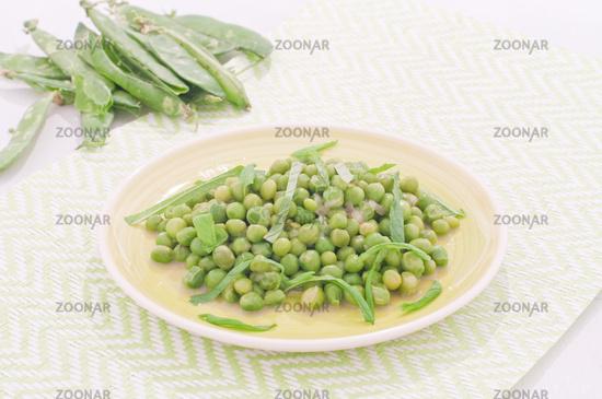 Fresh green peas stews seasoned with mint