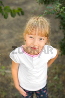 Portrait of a girl on the nature