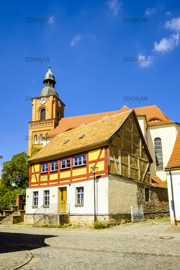 Half-timbered house in front of Parish church in Buckow, Brandenburg, Germany