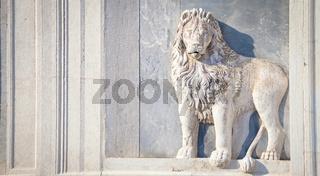 Marble lion on church facade