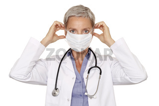 Female Doctor Putting On Surgical Mask
