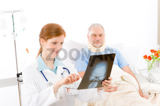 Hospital - female doctor examine x-ray patient