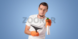 Housekeeper in front of a blue empty wall