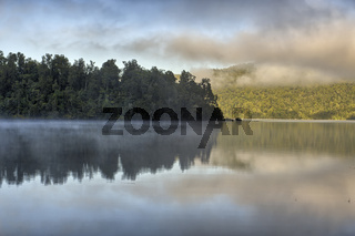 Trees reflected in Lake Kaniere