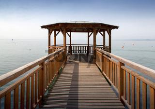Wooden pier and gazebo on a lake