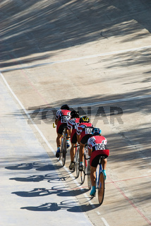 Cycling team racing on velodrome