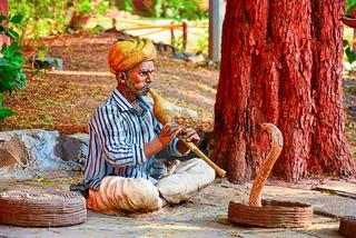 Indian snake charmer sculpture. Gram Sanskruti Udyan, Pashan, Pune, Maharashtra
