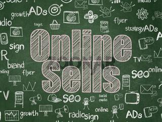Marketing concept: Online Sells on School board background
