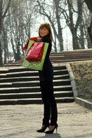 Glückliche Frau nach dem Shopping