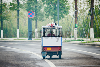 Rickshaw on the empty road at foggy morning time.