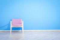 armchair blue wall