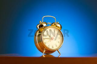 Alarm clock against colourful background