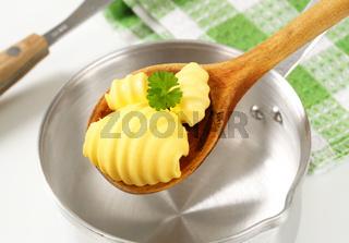 Butter curls on wooden spoon