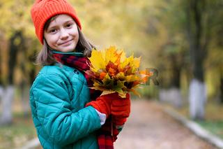 Girl on a walk in an autumn park
