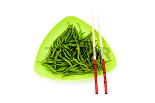 Hot peppers with chopsticks and plate