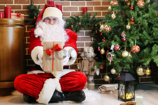Santa Claus with gifts Christmas tree