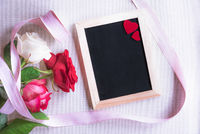 Chalkboard with red hearts and roses