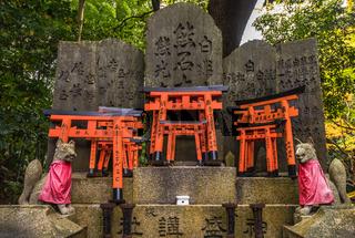 Fox sculpture in Fushimi Inari Shrine, Kyoto, Japan