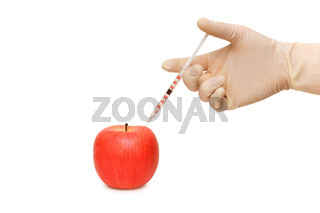 Hand with syringe and red apple on white
