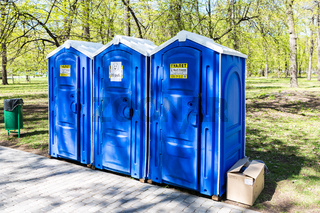 Mobile public toilets at the city park in summer sunny day