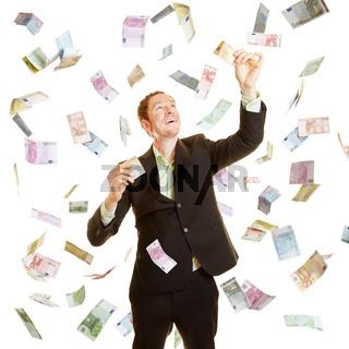 Geschäftsmann als Gewinner im Geldregen