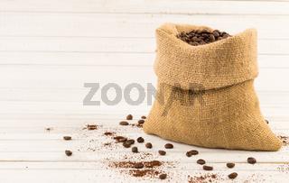 Jute coffee bag on white wood background