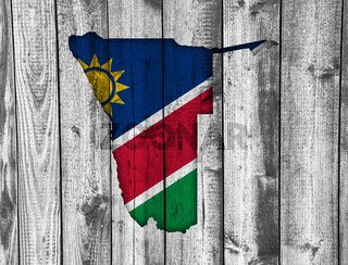Karte und Fahne von Namibia auf verwittertem Holz - Map and flag of Namibia on weathered wood