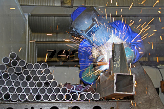 Man welding pipes