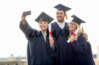 students or bachelors taking selfie by smartphone