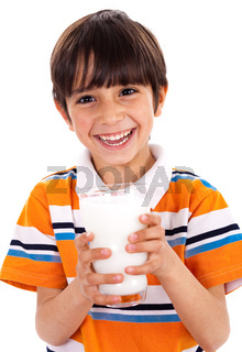 Young kid holding a glass of milk isolated on white background