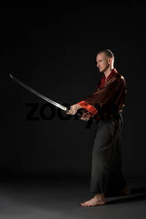 Young man in chinese costume with sword
