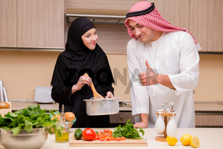 The young arab family in the kitchen