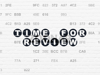 Time concept: Time for Review on wall background
