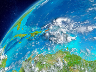 Space view of Puerto Rico in red