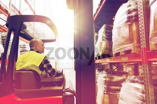 man operating forklift loader at warehouse